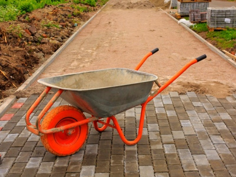 laying-paving-slabs-repairing-sidewalk-wheelbarrow_92397-301